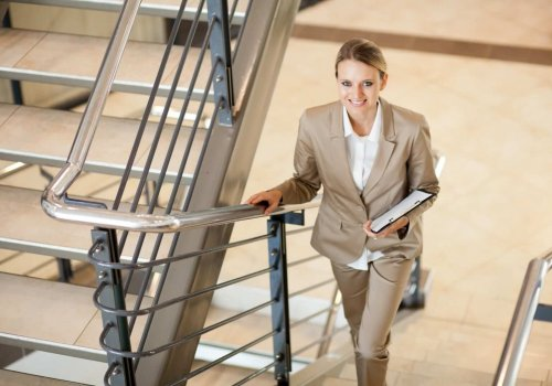 cute young businesswoman walking up stairs